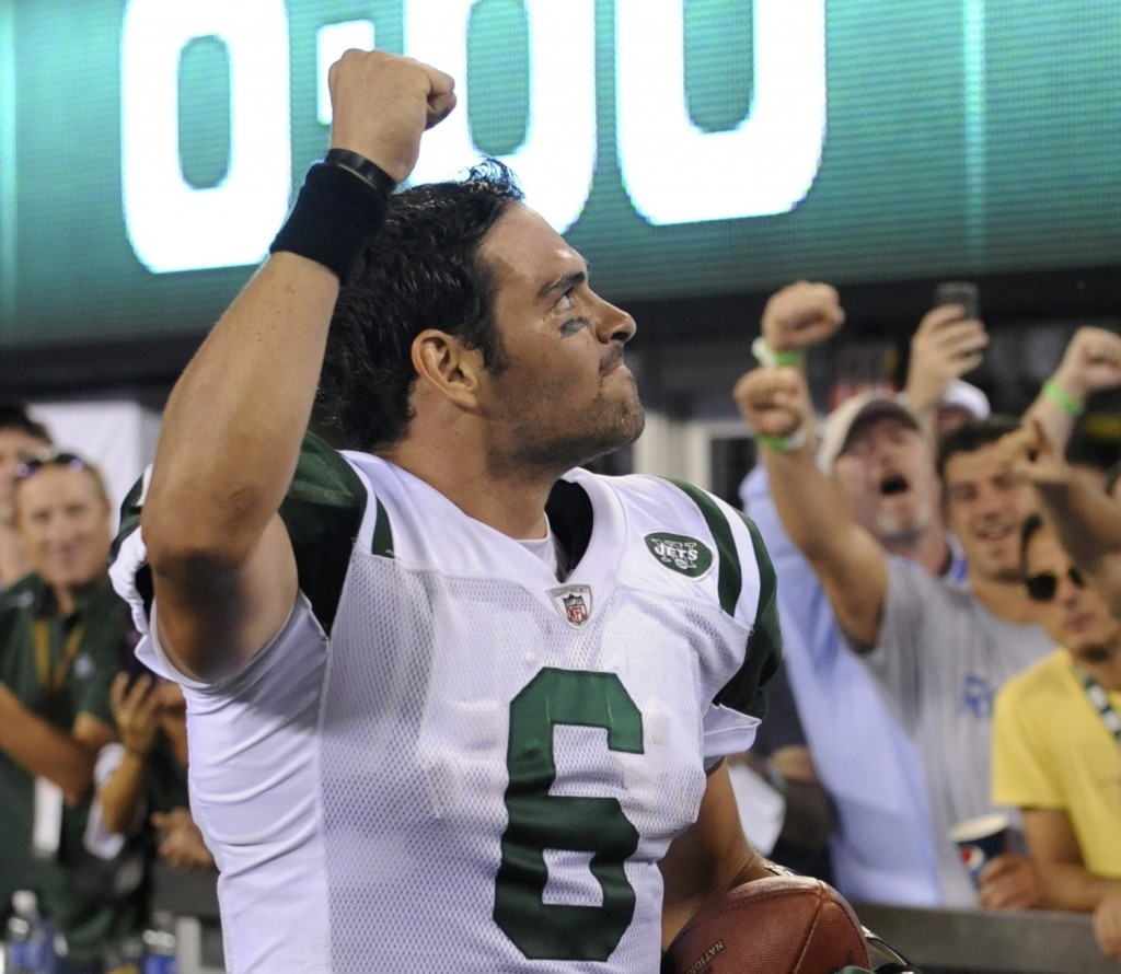 Mark Sanchez reacts to Jets fans as New York rallies past New England for its first win of the season.