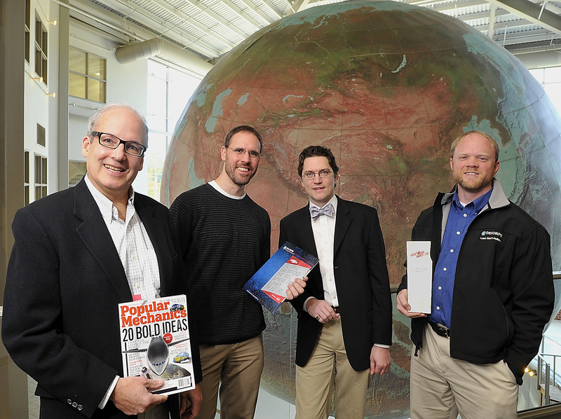 Caleb Mason, left, a DeLorme vice president, stands near the company's world globe with other company executives: Greg Wright, hardware engineer manager; Christian Ratliff, software developer manager; and Chip Noble, product manager.