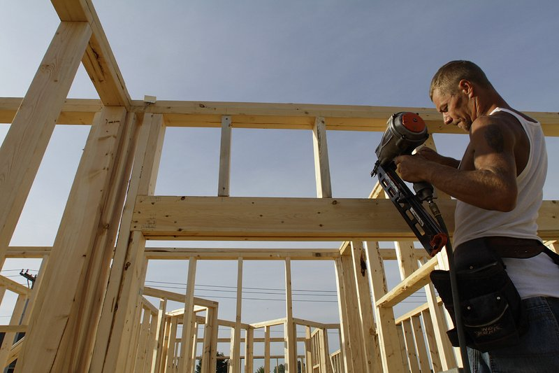 Construction worker Randy Shreves begins building a new home in Springfield, Ill., in September.