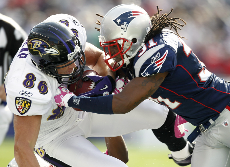 New England Patriots safety Brandon Meriweather , right, hits Baltimore Ravens tight end Todd Heap (86) during the first quarter Sunday in Foxborough, Mass. The Pats won in OT, 23-20.