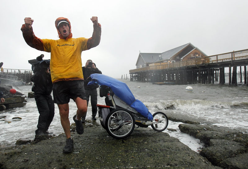 Mike Ehredt, of Hope, Idaho, celebrates the completion of his 4,425-mile coast-to-coast run today in Rockland. Ehredt, an Army veteran, started his run in Astoria, Ore., on May 1. He placed a flag every mile to honor service members lost in Iraq.