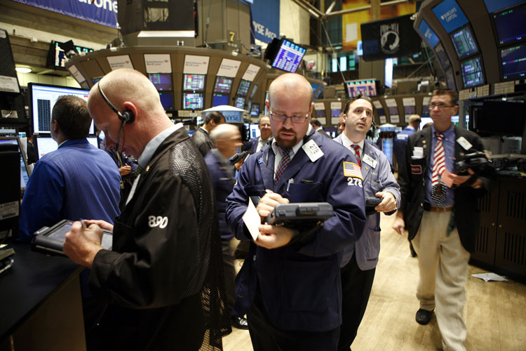 Traders and specialists work the trading floor of the New York Stock Exchange recently. On May 6, the Dow Jones had been down about 2.5 percent at 2:30 p.m., when a trader placed an enormous sell order on a futures index of the S&P's index, called the E-Mini S&P 500. The trade was automated by a computer algorithm that was trying to hedge its risk from price declines.
