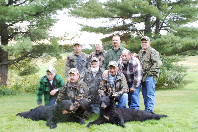Hunters from New Jersey gather around guide Wayne Bosowicz and the two black bears shot by two members of the hunting party on Sept. 15 near Pittston Academy Grant north of Moosehead Lake.