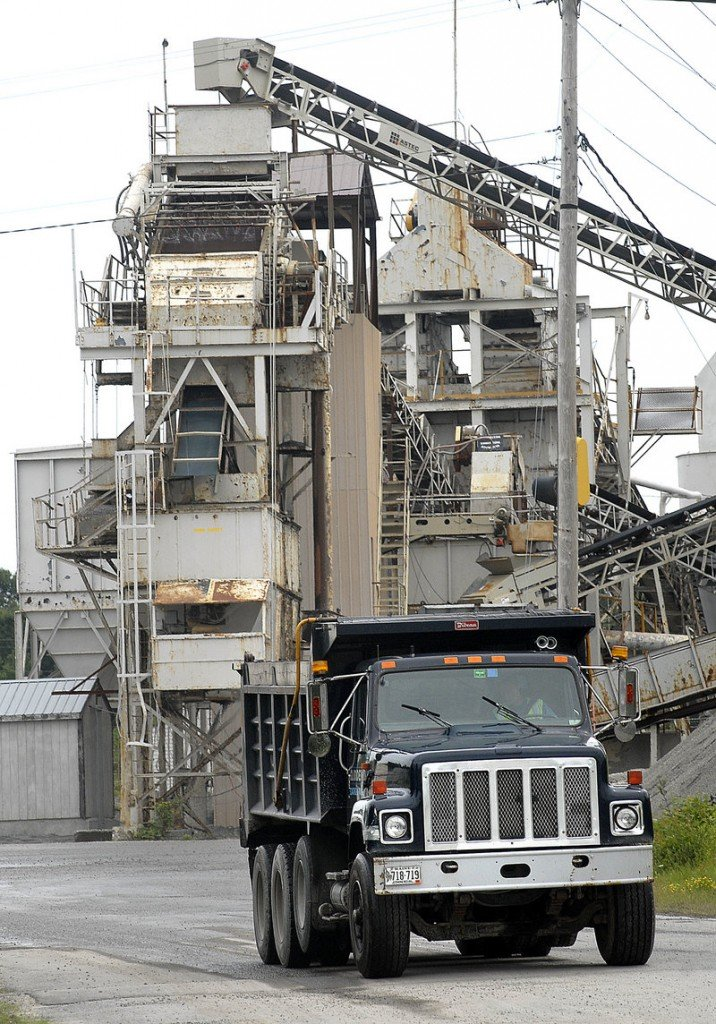 A truck leaves Pike Industries facility in Westbrook. The firm s application to blast at a local quarry remains disputed by neighbors.