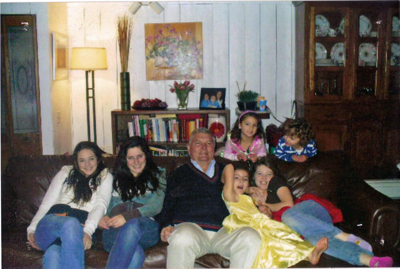Bryant Nicholson hangs out with his six grandchildren last Christmas. From left to right on the couch are Lauren, Shannon, Mia and Megan. Behind them are Ava, left, and David.