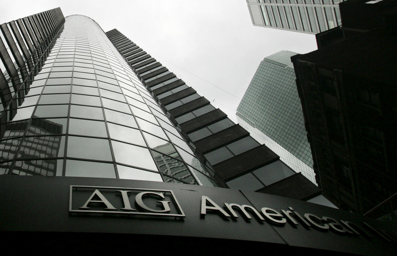 An AIG office building towers above the street in New York City. The New York Fed gave the insurer an $85 billion emergency loan in September 2008, and that bailout eventually grew to a taxpayer commitment of more than $180 billion.