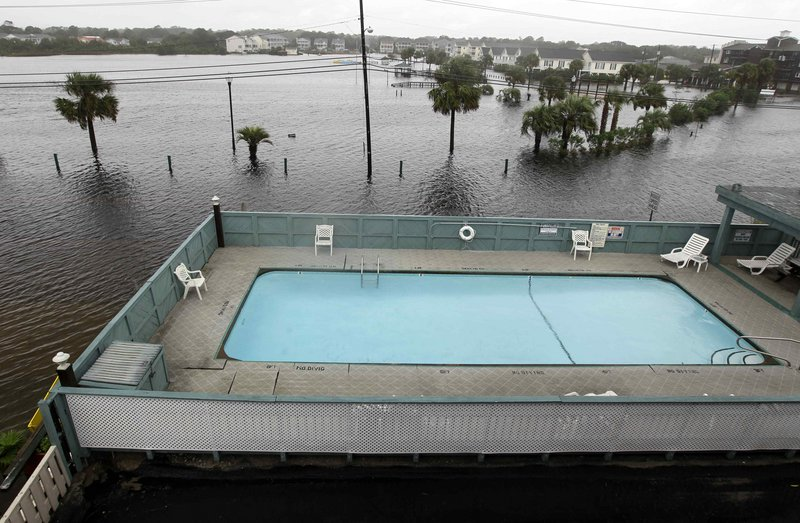 Floodwaters surround a condominium's pool in Carolina Beach, N.C., on Thursday. The hardest rain from Thursday's storm drenching the East Coast fell in North Carolina.