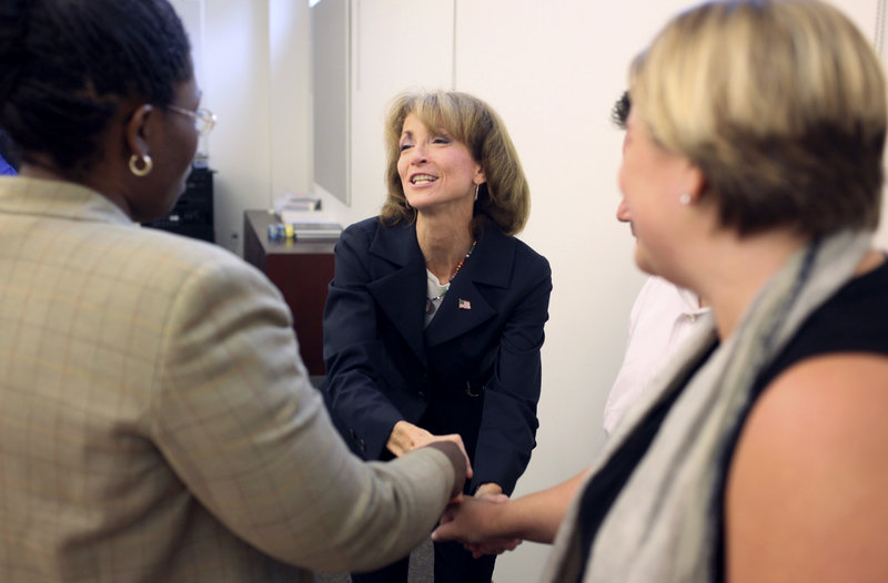 """New York Republican House candidate Nan Hayworth shakes hands with members of the Westchester Putnam Association of Realtors in Westchester, N.Y., this week. """"I do think we're going to have a big Republican wave,"""" Hayworth says. """"Very few people look at what's going on now and say, 'Yeah, I want more of that.'"""""""