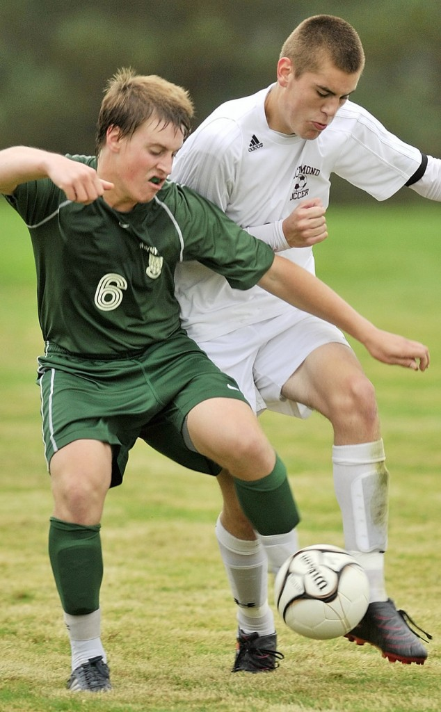 Daniel Wiener of Waynflete, left, contends for the ball with Tom Carter of Richmond during their schoolboy soccer game Thursday. The game ended in a 2-2 tie.