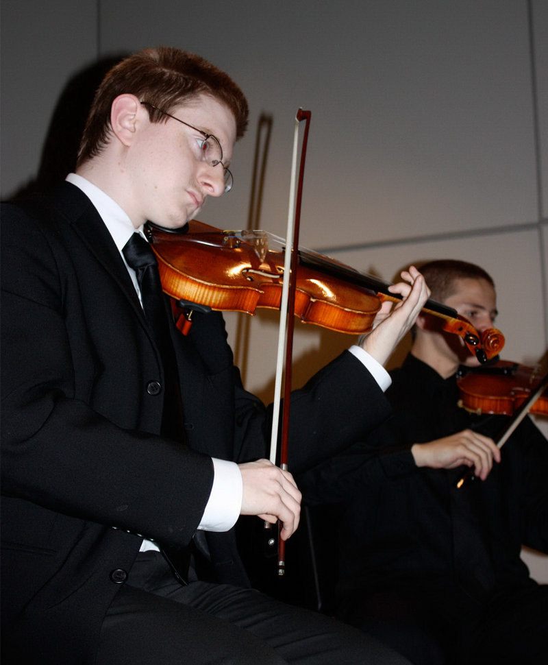 Tyler Clementi, a Rutgers University freshman who leapt to his death from the George Washington Bridge after a cyberbullying incident, plays at a 2009 benefit. He spoke through his violin, his music teacher said.