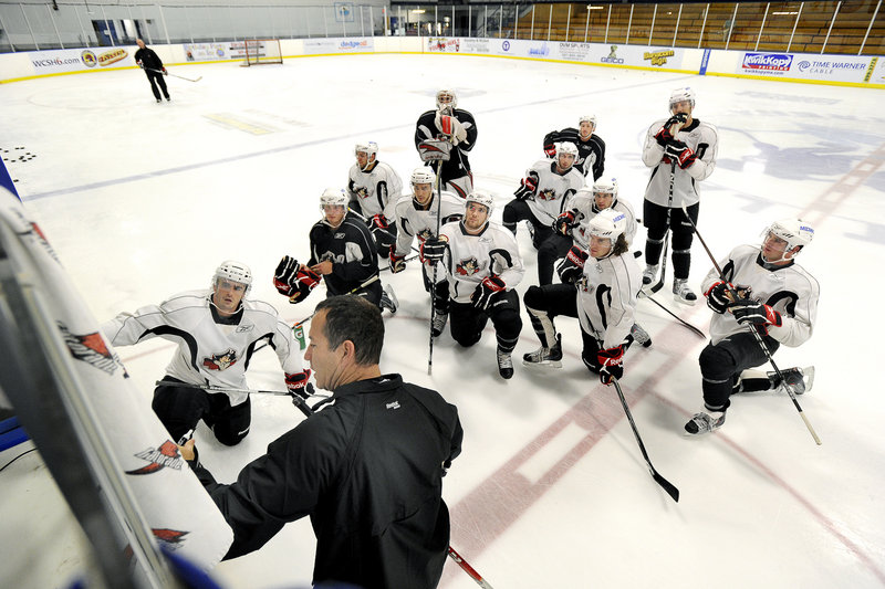 Pirates Coach Kevin Dineen works with a whole lot less than a full group Friday for the team's first practice at the Portland Ice Arena. The Pirates will have to come together in a hurry – they have one exhibition game Tuesday before the regular season opens Oct. 9.