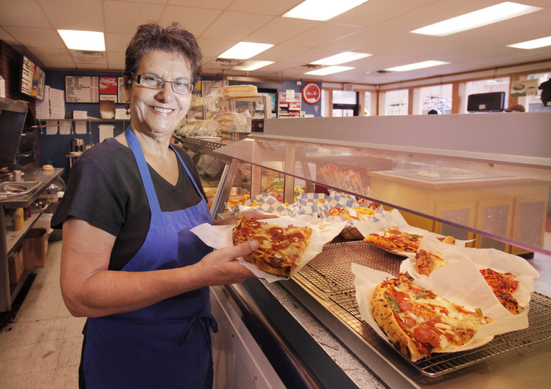 Bridget Colucci Jacobsay has worked at Colucci's in Portland for more than 20 years. The store, a longtime fixture on Munjoy Hill, has a wide array of lunch offerings and also sells prepared dinners to go.