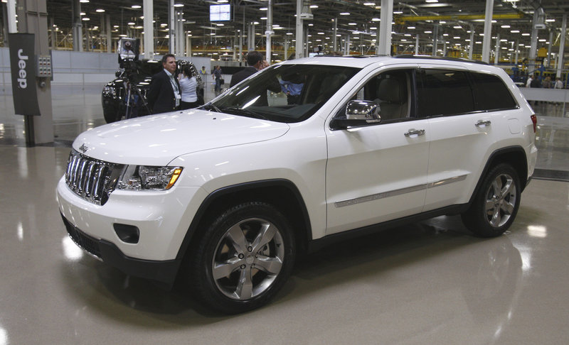 The 2011 Jeep Grand Cherokee, left, has been one of the bright spots in the auto industry, as low gas prices have helped to kindle consumer interest in crossovers, which are SUV bodies on car frames.