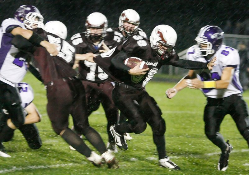 Windham running back Colby Waterhouse fends off Marshwood's Jack Verrill while breaking through the line on a first-half run. Waterhouse teamed with Cody Laberge to give the Eagles a strong running game in a 35-6 win.