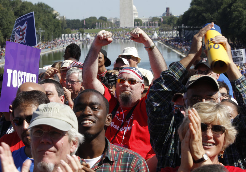 Activists gather at the Lincoln Memorial to participate in the
