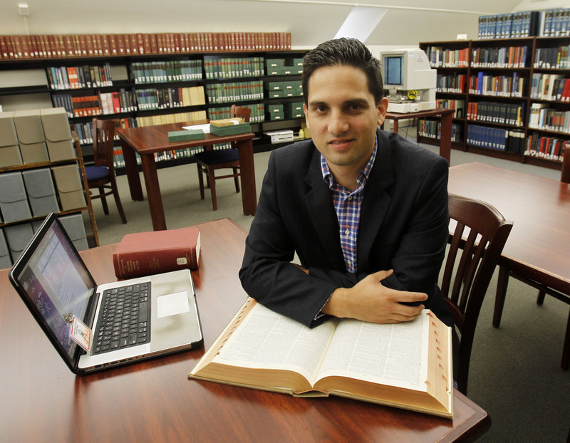 Justin Taylan sits in the Franklin D. Roosevelt Presidential Library and Museum in Hyde Park, N.Y. The 32-year-old has visited hundreds of sites in the Pacific in his effort to locate U.S. plane and ship wreckage and determine the fates of American troops still listed as missing in World War II.