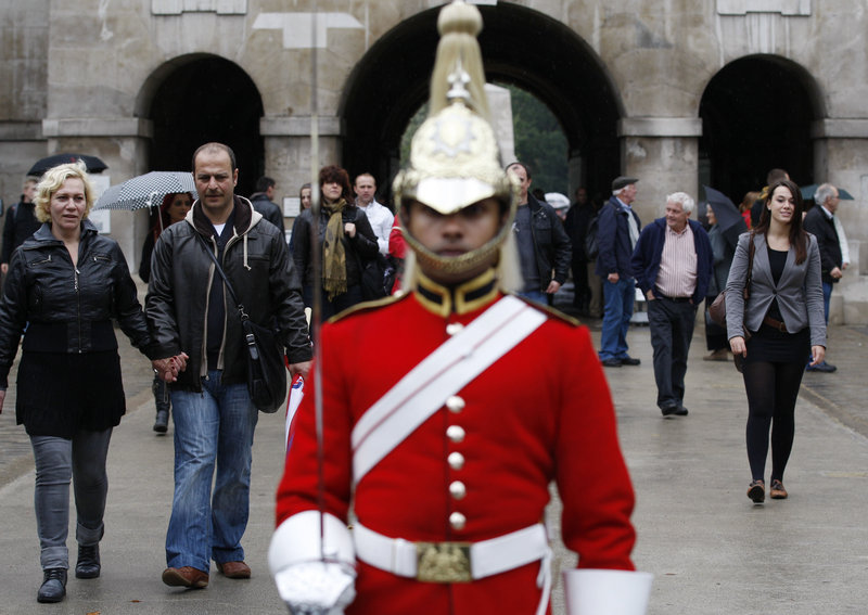 Tourists visit the Horse Guards Parade in London on Sunday. The U.S. government has warned its citizens in a new travel advisory to be vigilant while traveling in Europe because of the threat of an al-Qaida commando-style attack. The State Department advised nationals to take care while in tourist areas.