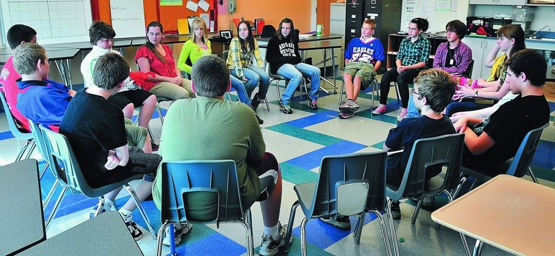 """Eighth-graders form a """"community circle"""" to discuss topics and voice opinions at Messalonskee Middle School in Oakland. The circle concept is the cornerstone of a disciplinary approach that requires students to face each other to resolve conflicts."""