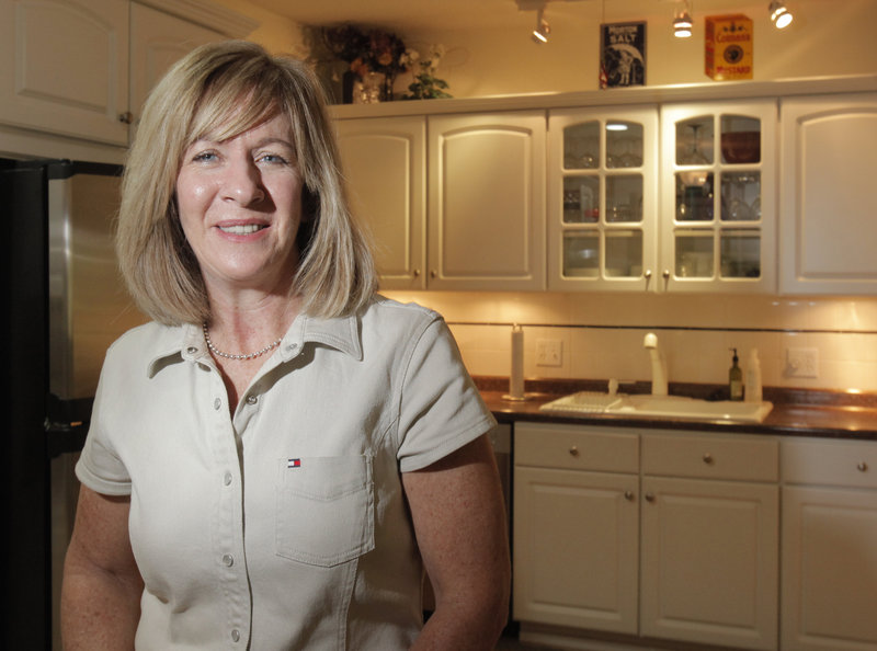 Marianne Mosesso, a broker with Coldwell Banker, is shown in a condominium at Cider Hill in Old Orchard Beach that is under contract.