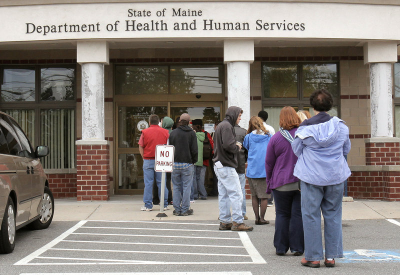 People wait outside the Department of Health and Human Services' Portland office. The recession and the election have made aid to the poor an emotionally charged issue in the race for governor in Maine.