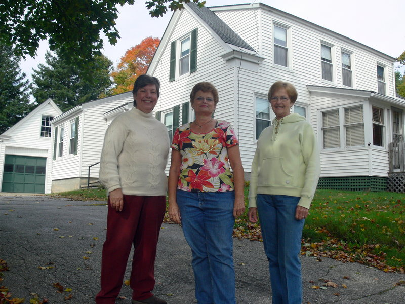 Windam Historical Society presidents, from left, Linda Hanscom, Isabelle Gilman and Norma Rogers stand at October House, located next to the society's current home.