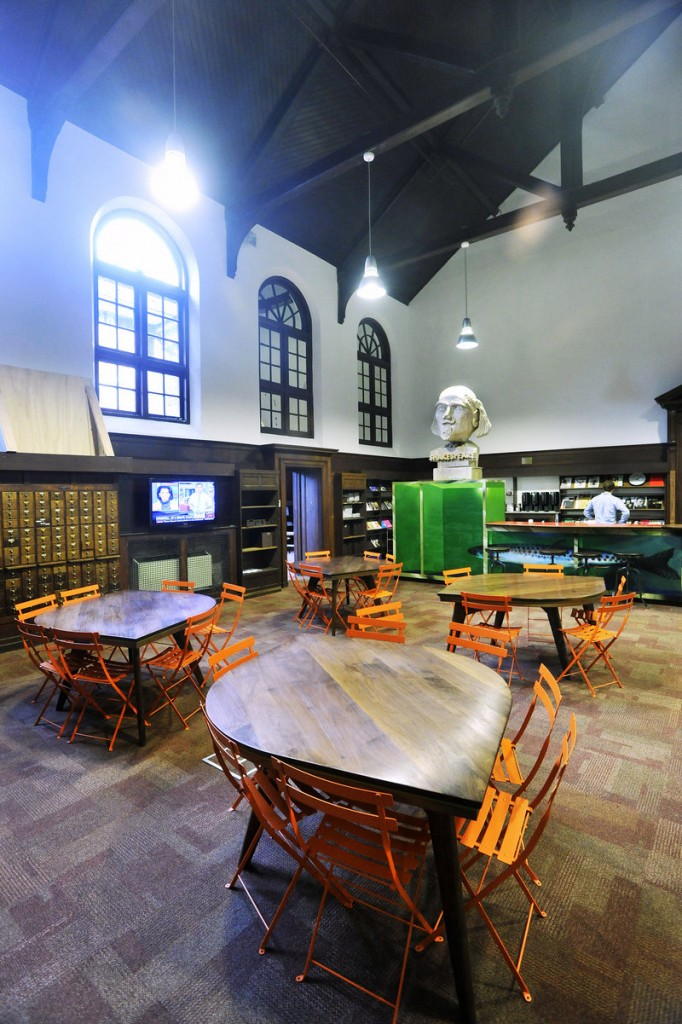 A meeting and lunch area serves as a hub for the advertising and marketing firm. Contemporary furniture is used to accentuate the late-1800s details of the building.