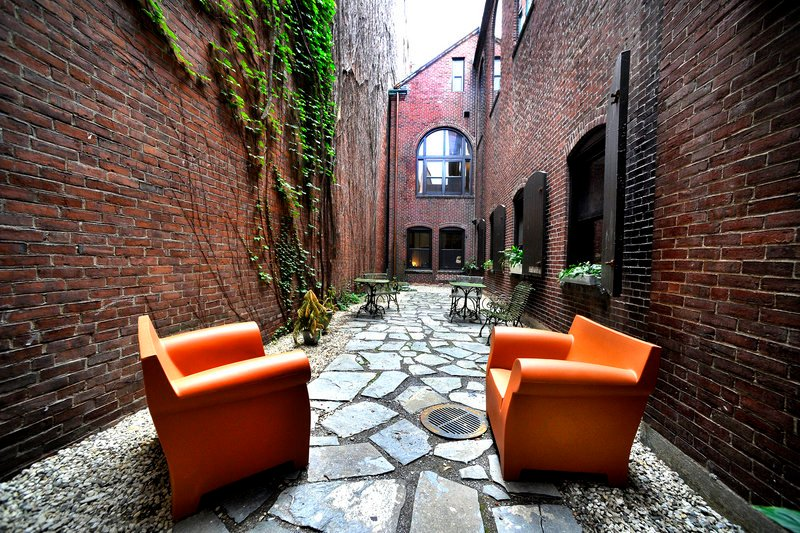 A narrow outdoor space is called the Zen Garden by VIA Group staff.