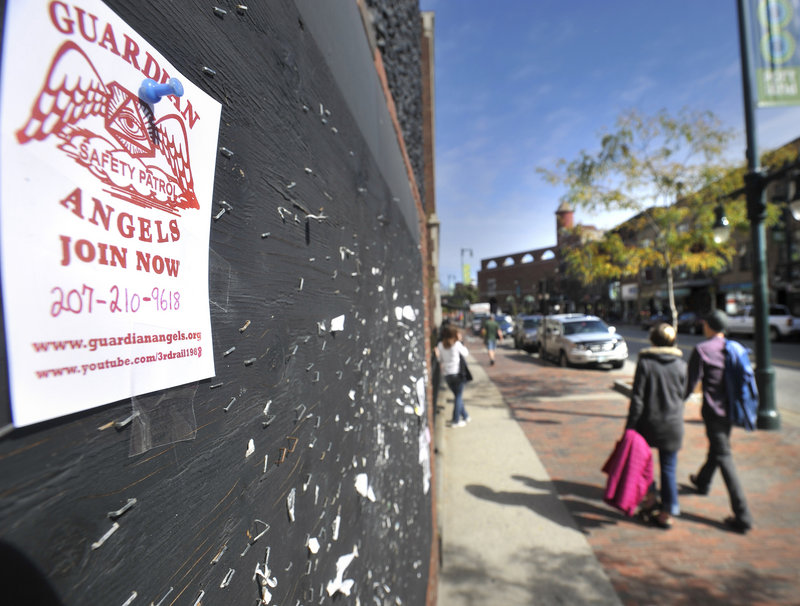 A sign on Congress Street seeks volunteers for a chapter of Guardian Angels now forming up in Portland, organized by a private citizen.