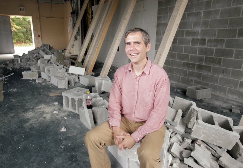 Brett Wickard, owner of Bull Moose, is renovating space next to his Scarborough store to make room for 20,000 books.