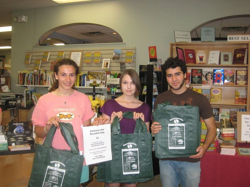Chloe Maxmin, Sloane Fossett, Dana Malseptic, from left, pose with a sample bag for their proposed Damariscotta Reusable Bag program. Maxmin designed the bag and led a campaign to raise money and awareness for the reusable bag program that, to date, has kept some 700,000 plastic bags from ending up in the local landfill.