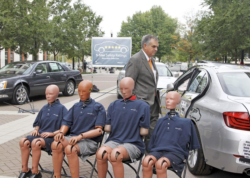 Transportation Secretary Ray LaHood leaves a news conference Tuesday after announcing a new five-star vehicle safety rating system. The 2011 BMW 5 Series and a version of the 2011 Hyundai Sonata were the only vehicles to get five stars.