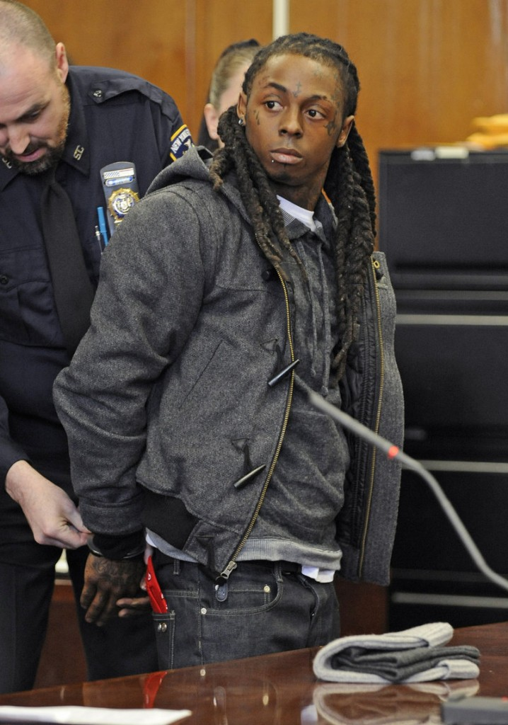 """Rapper Lil Wayne is handcuffed at Manhattan criminal court in 2008. He had the best-selling album that year, """"Tha Carter III,"""" and won a Grammy."""
