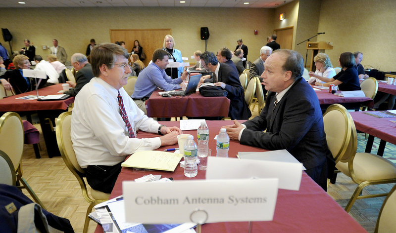 Norm Cheever of Cobham Antenna Systems in Exeter, N.H., talks with Richard Ferrara of Azymuth Telecom and Tailgent in Monmouth at Wednesday's small business conference at the Wyndham Hotel in South Portland.