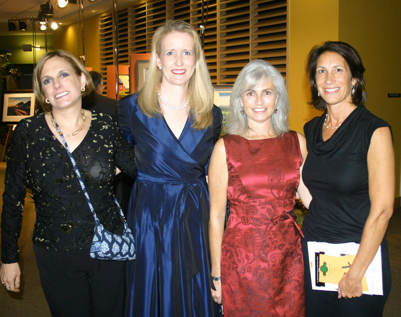 Event co-chairs Amy Hawkes and Karen Watterson, center, stand with past event chairs Stephanie Takes-Desbiens, left, and Kim Dorsky, right.