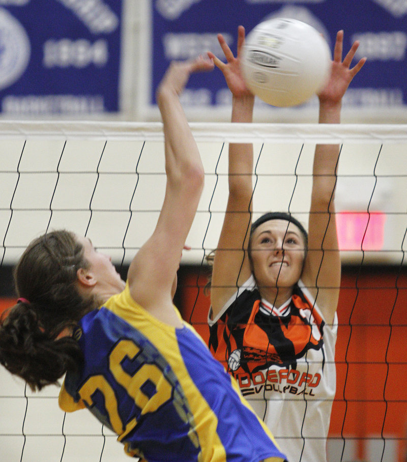 Biddeford s Renee Trottier blocks the shot of Falmouth's Nicole Rogers during their game Wednesday night. The Tigers took a five-game thriller as Biddeford won the matchup of top Class A teams.