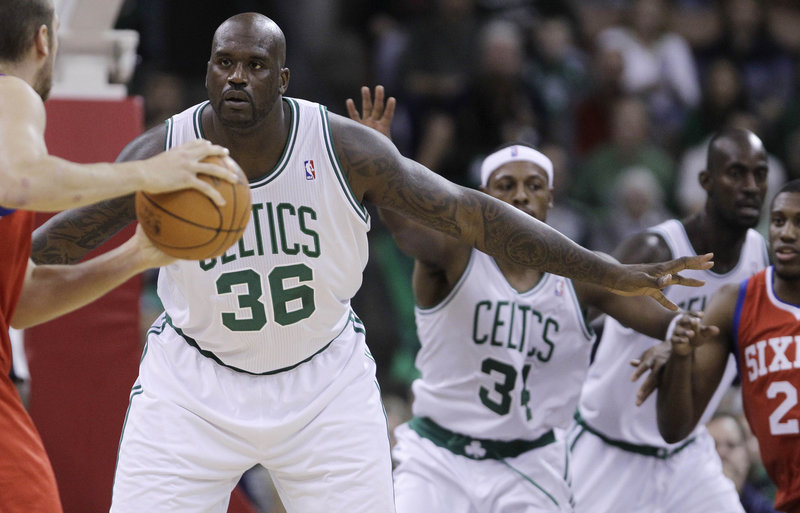Shaquille O'Neal defends against the Philadelphia 76ers in Manchester, N.H., on Wednesday. It was O'Neal's debut in a game for the Celtics. He scored eight points in 15 minutes.