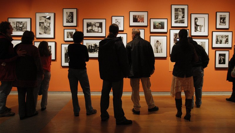 Visitors view a Portland Museum of Art exhibition in 2009. A survey solicited by the Maine Arts Commission has concluded that Maine's museums attract hundreds of thousands of visitors who stay in hotels and B&Bs, spend money in local communities and travel widely across the state.