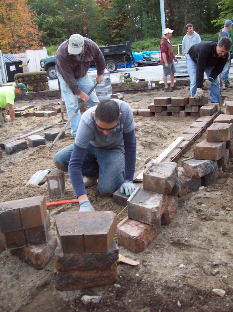 Luis Juarez of Sabra Property Care in Cumberland works on the raised beds.