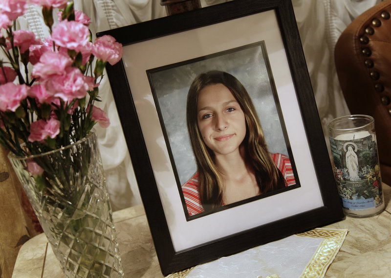 """A portrait of Sladjana Vidovic, who committed suicide in 2008, sits in the living room of her family's Mentor, Ohio, home. One of several Mentor High students who killed themselves in recent years, Sladjana """"didn't have enough strength"""" to withstand bullying at school, a friend says."""