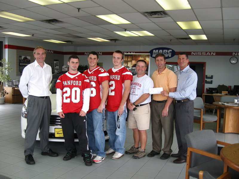 From left are Marc Motors general manager Ed Marshall, SHS football captains Shawn Goodrich, Jon Antara and Justin Carlson, Coach Mike Fallon, Marc Motors service manager Phil Royer and owner Marc Greenberg.