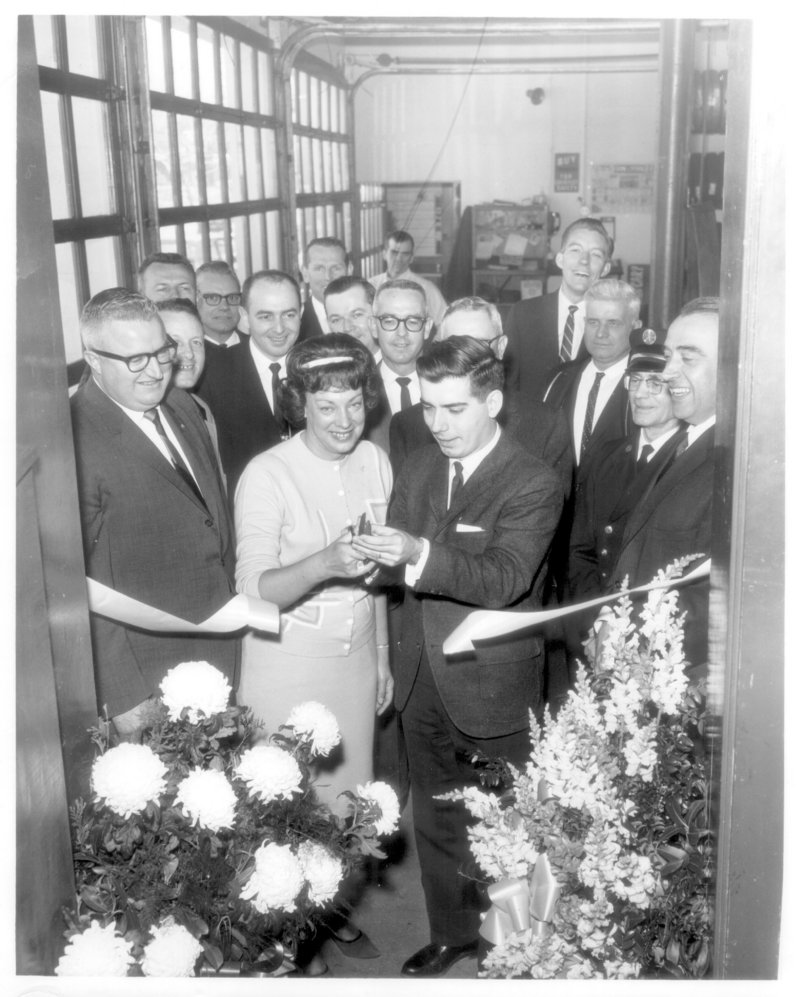 Thomas O. Auger and his wife Mildred mark the grand opening of an L&A Tire store in the early 1960s.