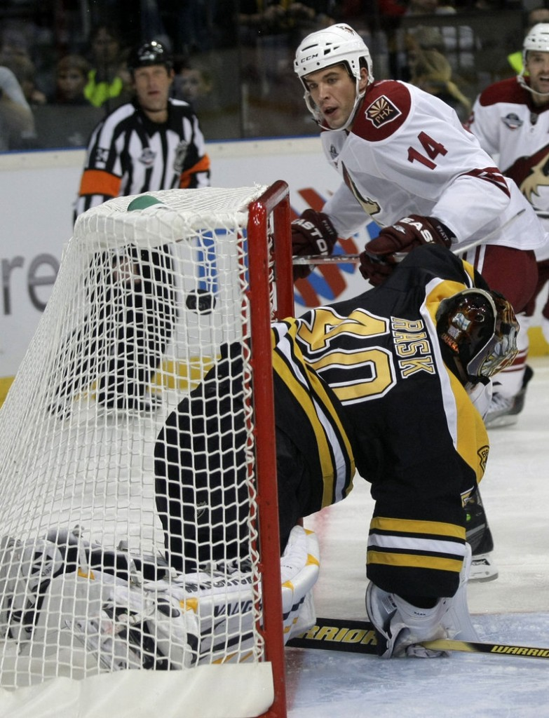 Taylor Pyatt of the Phoenix Coyotes watches his shot sail past Bruins goalie Tuukka Rask for a second-period goal in their season opener Saturday in the Czech Republic. The Coyotes won, 5-2.