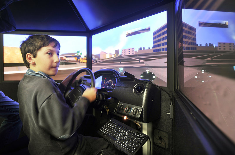Caleb Cram, 12, of South Portland tries his hand at operating an emergency vehicle driving simulator at the Portland Fire Museum on Spring Street.