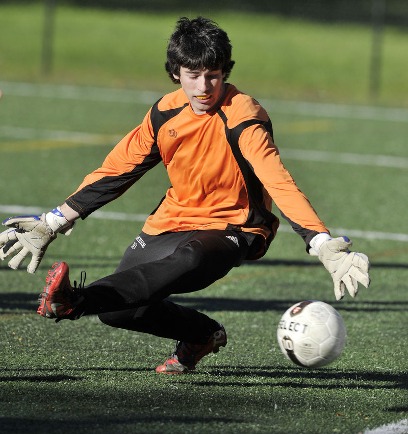 Lake Region goalie Dakota Bush comes up with one of his 24 saves Saturday in a Western Maine Conference boys' soccer game at North Yarmouth Academy. NYA scored in each half to come away with a 2-0 victory.