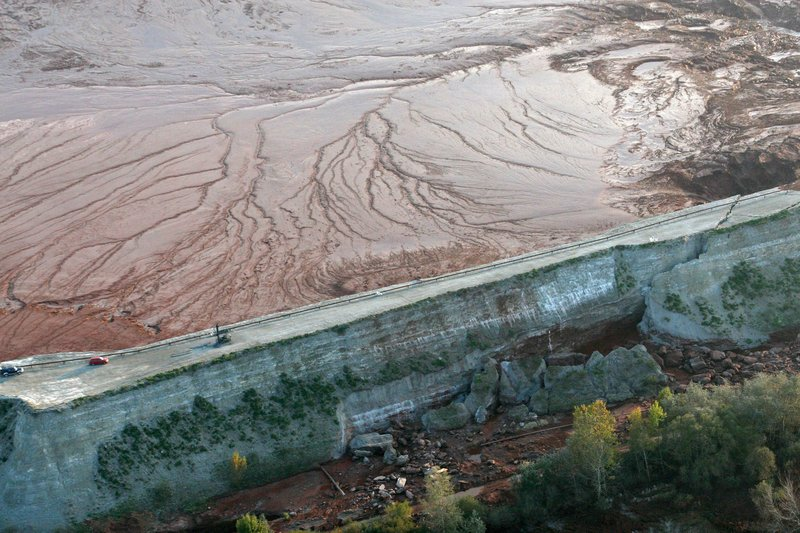 An aerial view shows the cracked northern wall of the reservoir containing red sludge from an alumina factory near Ajka, southwest of Budapest, Hungary, on Sunday. The reservoir has released tons of caustic red sludge, which flooded villages in the area.