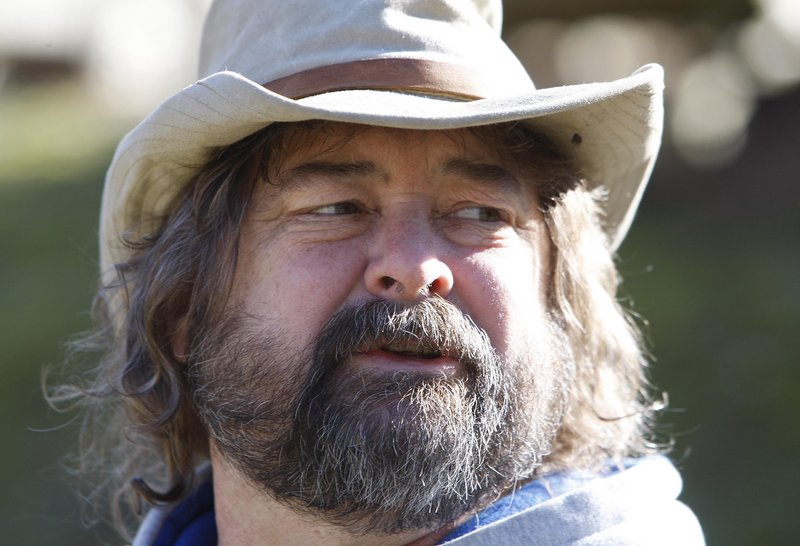 Mickey McCoy, above, a local activist, is shown at Coldwater Creek near Inez, Ky., in 2008. Coldwater Creek was one of two creeks where the massive Martin County sludge spill occurred in 2000.
