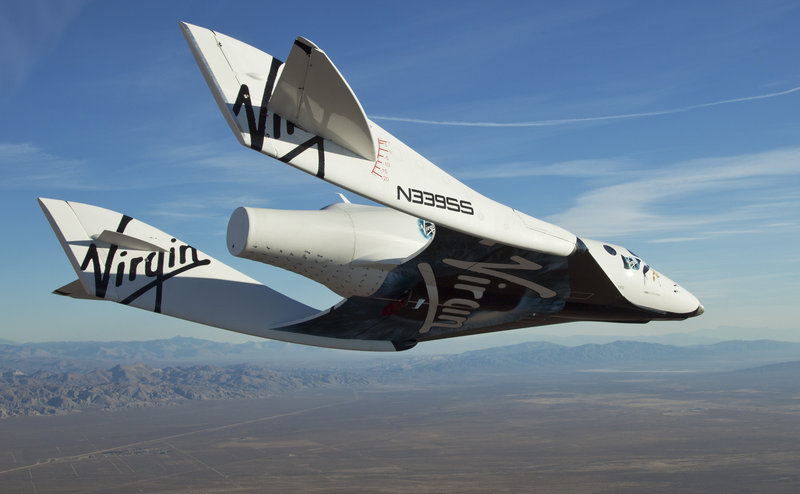 The Virgin Galactic SpaceShipTwo, or VSS Enterprise, glides to the earth on its first test flight. The craft, which is capable of blasting into space, was carried aloft and released by a mothership over the Mojave, Calif., area Sunday, then glided to a landing.