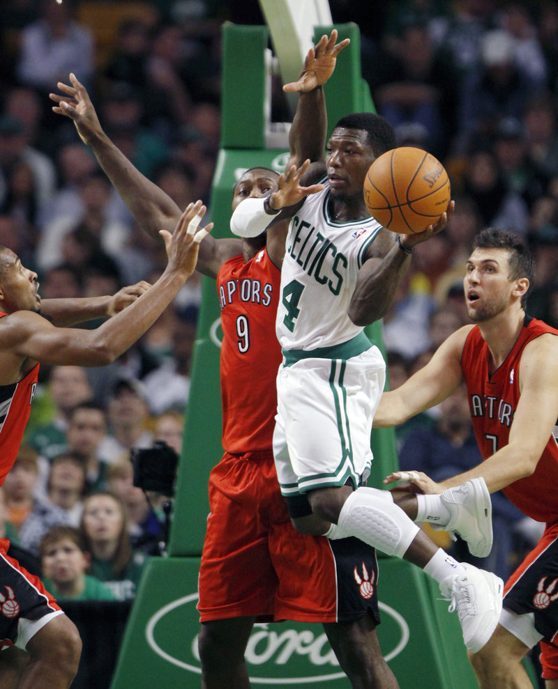 Nate Robinson distributes the ball on the move Sunday during Boston's exhibition with Toronto at TD Garden in Boston. Robinson scored 13 points.