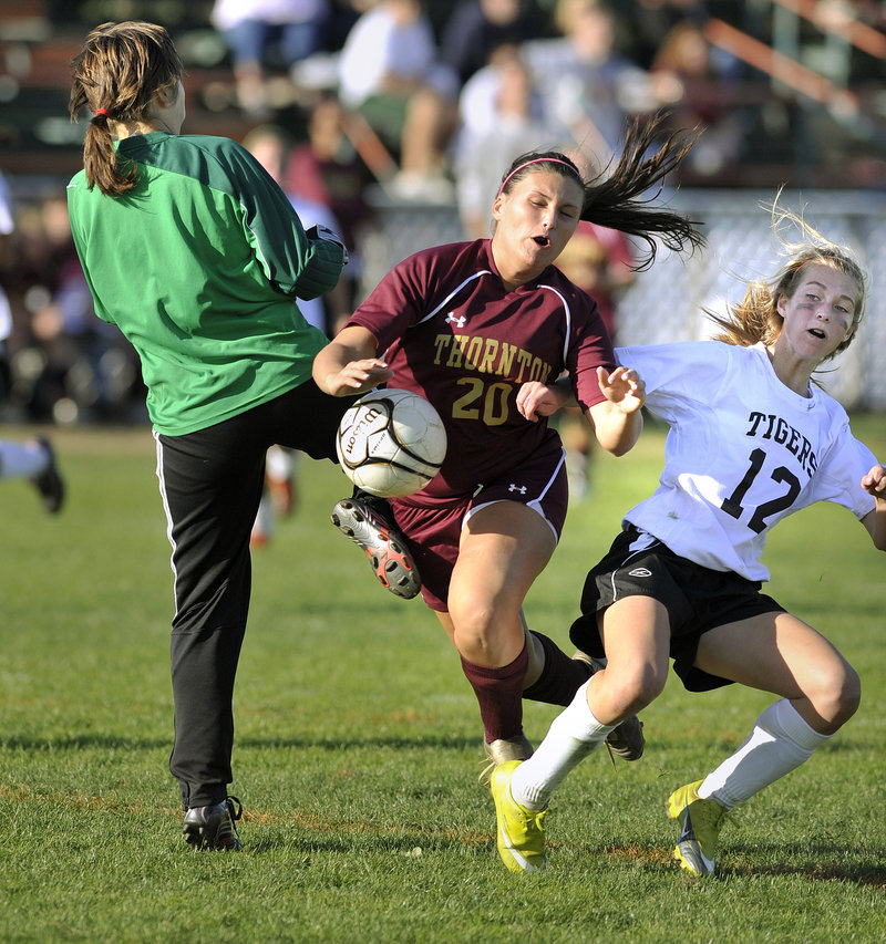 Ashley Kane's scoring bid for Thornton Academy is broken up by Biddeford goalkeeper Adrienne Bowie, with help from Olivia Jones. Kane was one of five goal scorers for the Trojans in a 5-0 victory.