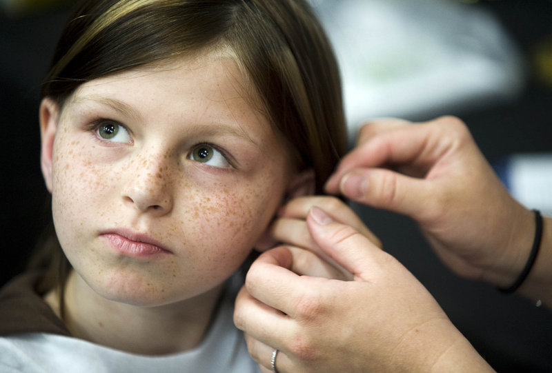 Zahra Clare Baker, 10, is shown in May getting a hearing aid. Police indicated Tuesday that they believe someone killed the 10-year-old North Carolina girl who has bone cancer.